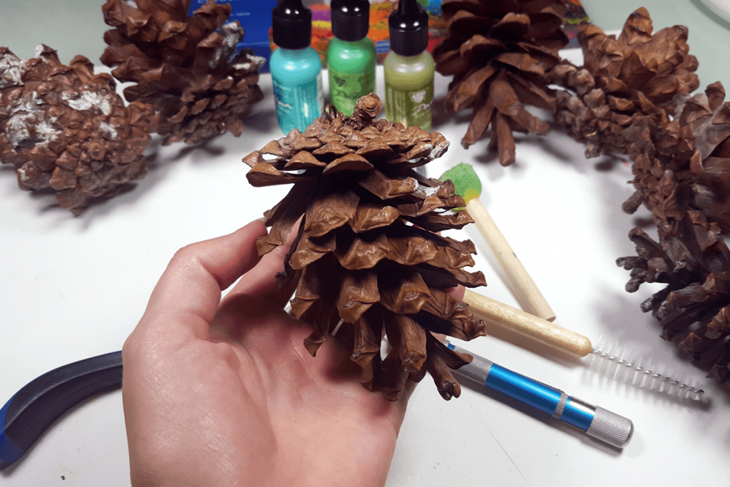 Creating New Year Tree Toys from natural pine cones 4