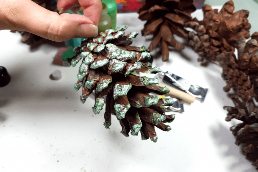 Creating New Year Tree Toys from natural pine cones 17
